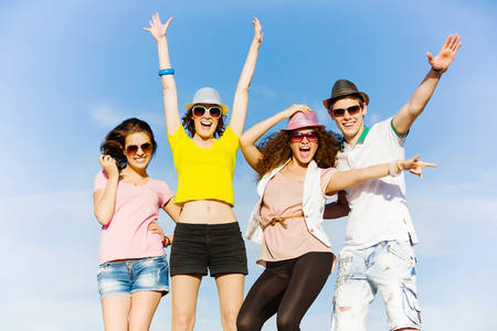 Young happy people having fun outside in summer photo