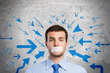 Young handsome businessman with adhesive tape on mouth Stock Photo - 24935511