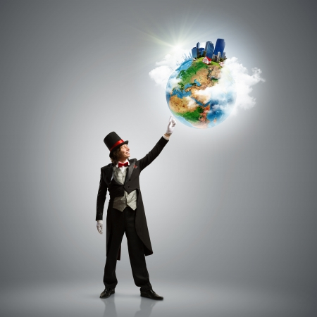 Image of magician in hat holding globe  Ecology concept  Elements of this image are furnished by NASA