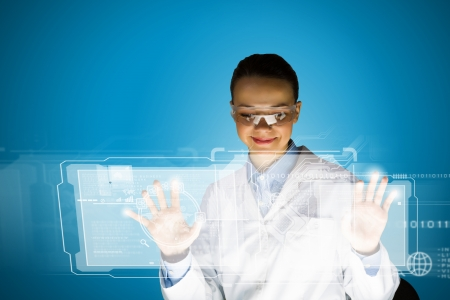 eye wear: Image of young attractive woman scientist in protective eye wear Stock Photo