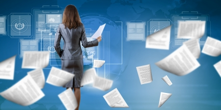 Back view of businesswoman holding papers in hands Stock Photo