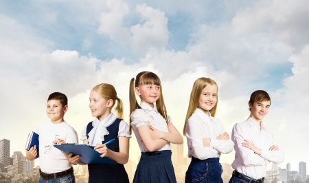 Group of pupils holding items  Education and travel concept Stock Photo - 24949115