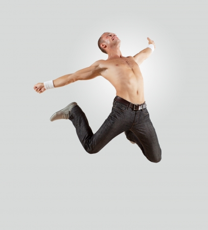 Modern style male dancer jumping and posing  Illustration photo