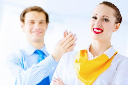 joyfully: Image of businessman and businesswoman smiling joyfully Stock Photo
