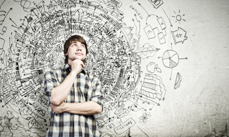 creative communication: Young thoughtful handsome man in casual thinking over the ideas