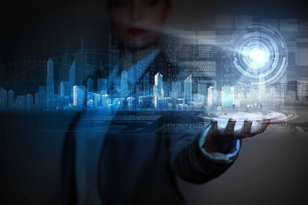 Businessperson houden media beeld van de stad in de palm Nieuwe technologieën Stockfoto - 24976627