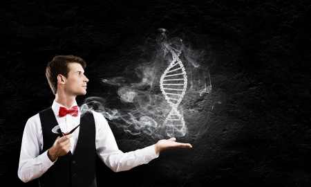 Young handsome businessman smoking pipe and holding dna image in palm