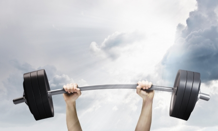 Lifting barbell above head  Strength and power Stock Photo