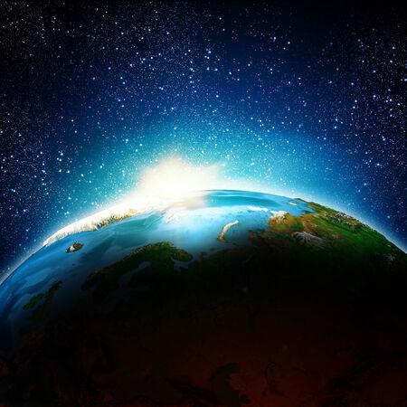 Sun rising above Earth planet Stock Photo - 24979456