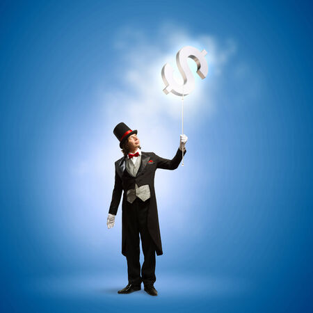action fund: Image of magician with dollar symbol in air Stock Photo