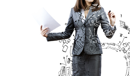 Businesswoman drawing business plan and sketches with marker Stock Photo