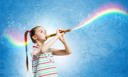elective: Image of little cute girl playing on flute