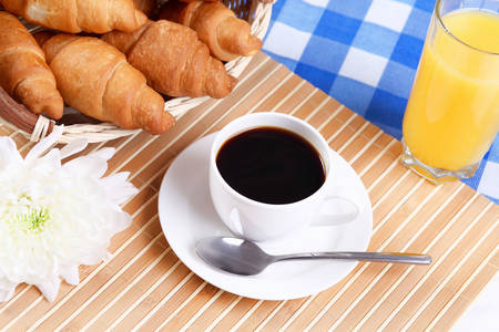 caf: Continental breakfast with croisant and black coffee Stock Photo
