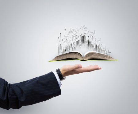 civil engineering: Businessman hand holding opened book in palm Stock Photo