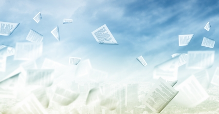 Background conceptual image with papers flying in air photo