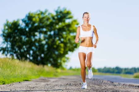 Image of young attractive woman running outdoor photo