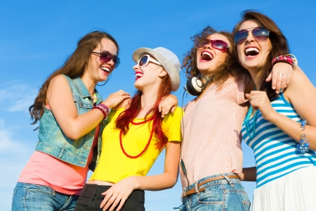 Image of four young attractive girls having fun outdoors photo