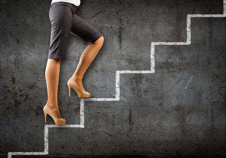 Image of businesswoman climbing career ladder  Success and achievement photo