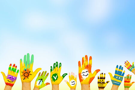Image of human hands in colorful paint with smiles Stock Photo