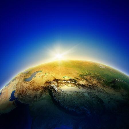 Sun rising above Earth planet  Conceptual photo Stock Photo - 24997297