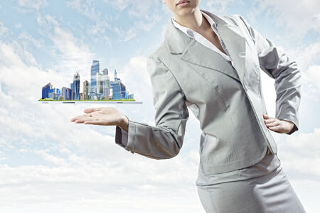 Businesswoman in suit holding tablet pc on palm photo
