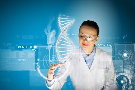 guanine: Woman scientist touching DNA molecule image at media screen