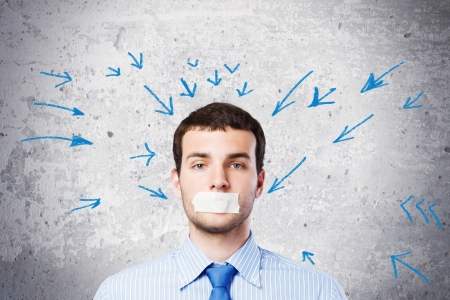 Young handsome businessman with adhesive tape on mouth Stock Photo - 25000157