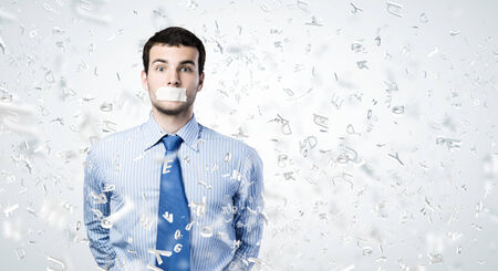 Young handsome businessman with adhesive tape on mouth Stock Photo - 25000262