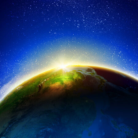 Sun rising above Earth planet  Conceptual photo  Elements of this image are furnished by NASA Stock Photo - 25000355