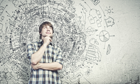 successful future: Young thoughtful handsome man in casual thinking over the ideas