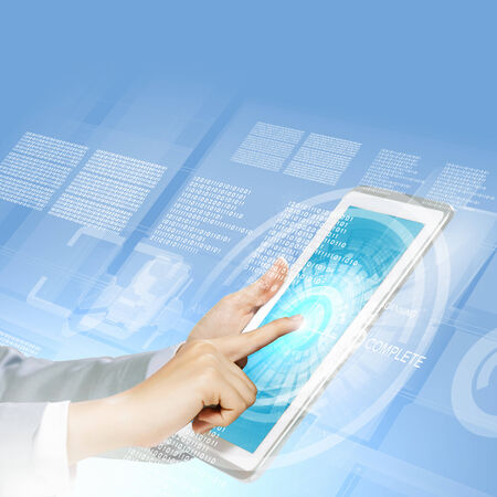 Close up image of human hand touching screen of tablet pc Stock Photo - 25005721