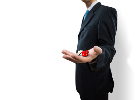 Close up of businessman throwing dice  Gambling concept photo
