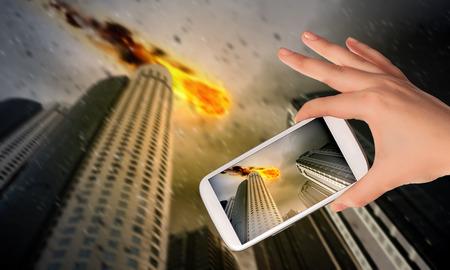 People taking photos of falling meteorite on mobile phone camera photo