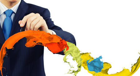 Businessman against white background drawing colorful splashes with marker