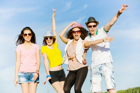 Young happy people having fun outside in summer Stock Photo
