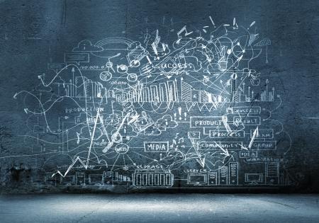 ビジネスのスケッチと図面を黒い壁に