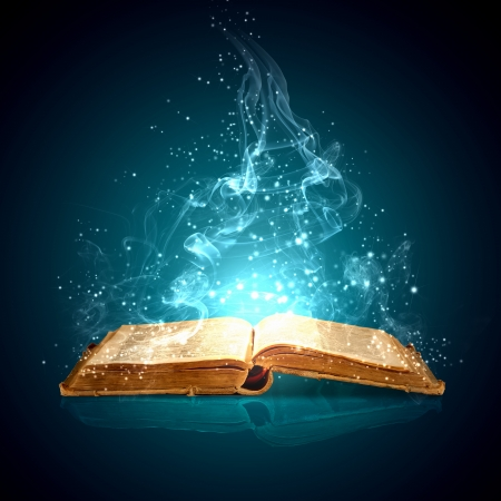 stories: Image of opened magic book with magic lights Stock Photo