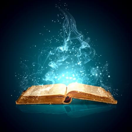 Immagine del libro magico aperto con luci magiche