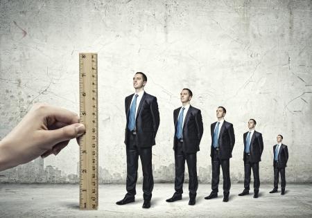 Successful confident businessmen standing in line  Progress in career Stock Photo