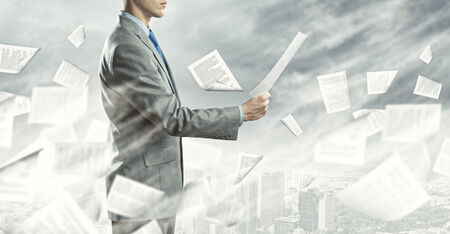 Businessman examining document in hands  Signing contract Stock Photo