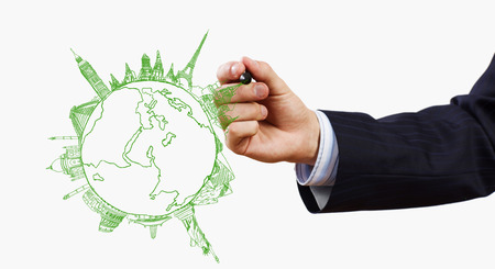 Close up of businessman drawing Earth planet photo