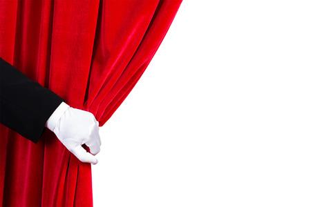 Close-up van de hand in witte handschoen opent het gordijn Plaats voor tekst