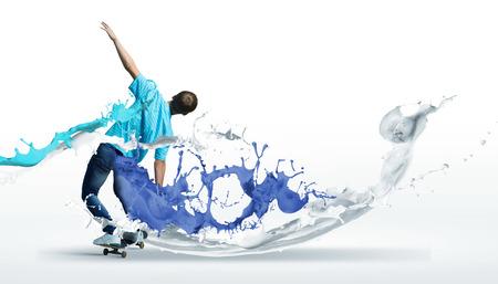 boy skater: Boy skater riding on board against white background Stock Photo