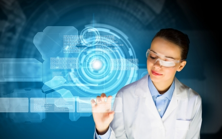 female scientist: Image of young woman scientist in goggles against media screen