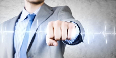 determinism: Close up image of businessman clenching fume in fist