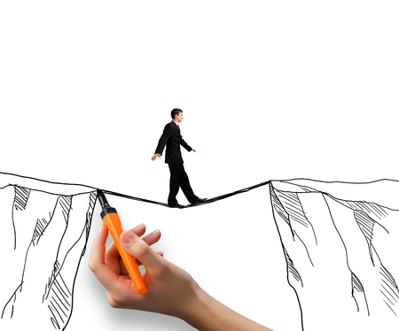 security gap: Brave businessman walking on rope above mountain gap