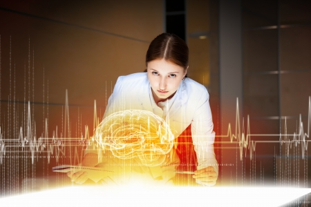 Image of young woman doctor  Concept of modern technology photo