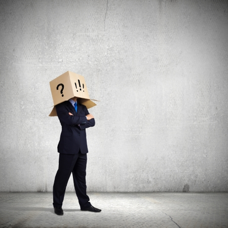 cant: Businessman with box on head expressing emotions
