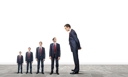 Successful confident businessmen standing in line  Progress in career photo