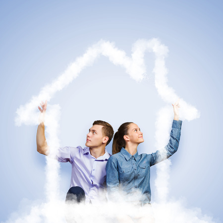 dream house: Conceptual image of young couple hugging each other and dreaming